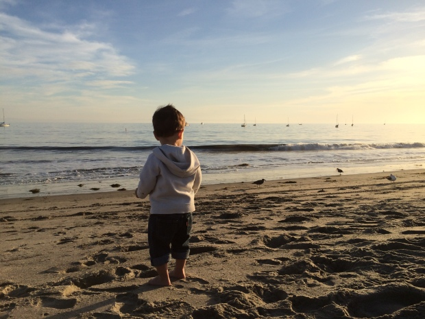 toddler on the beach during sunset