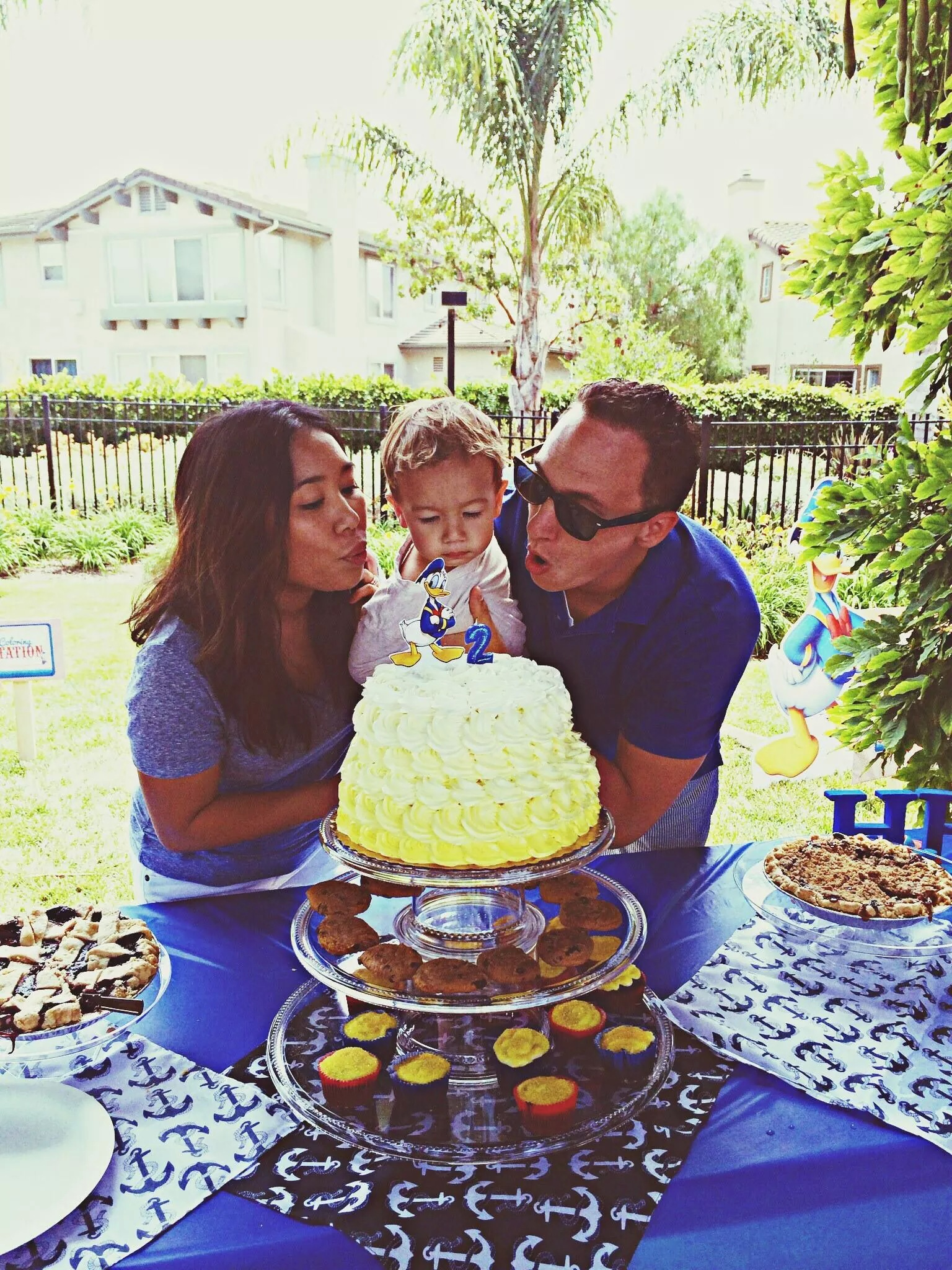 Blowing out candles // Donald Duck Nautical birthday cake
