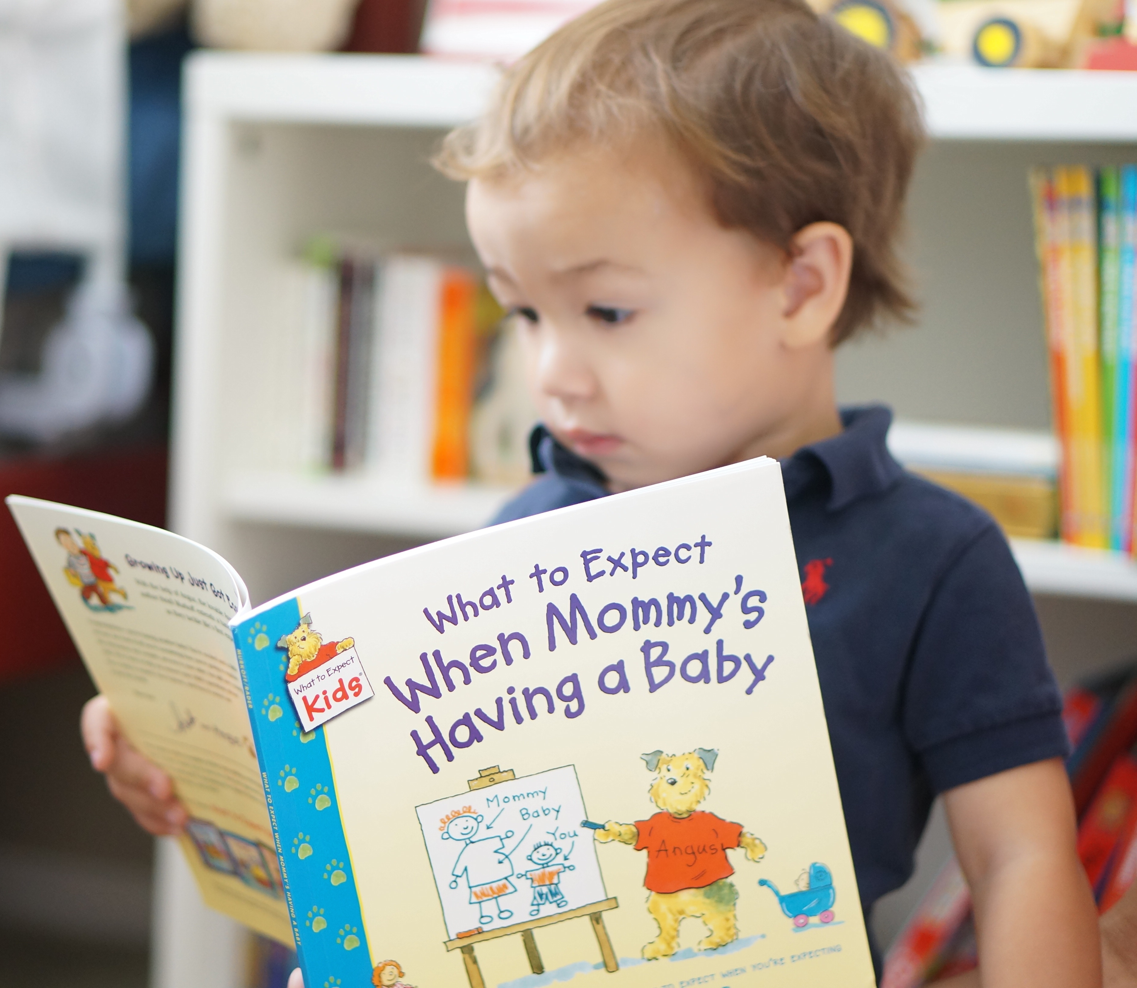 baby announcement // toddler reading book