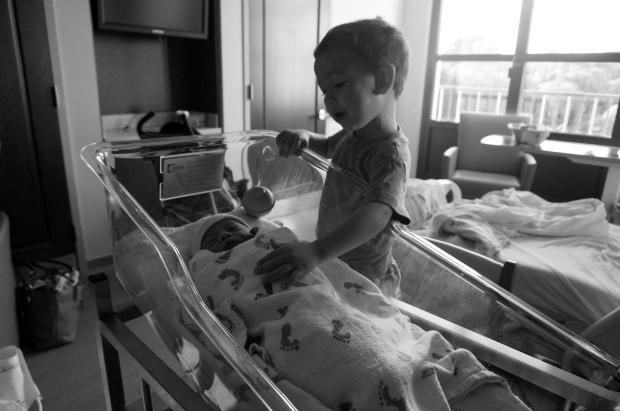 toddler with newborn